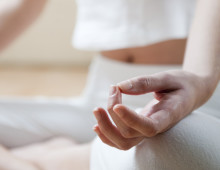 Hands of young woman meditating, focus on the hand